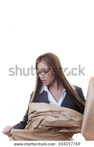 woman wrapped up in brown paper trying to get out - stock photo