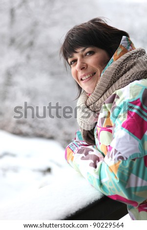Woman wrapped up in the snow