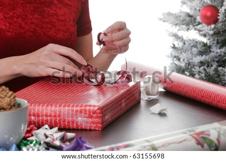 Woman wrapping christmas presents - stock photo