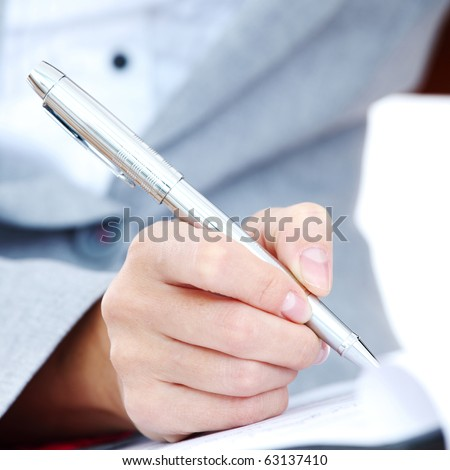 woman write by pen - stock photo