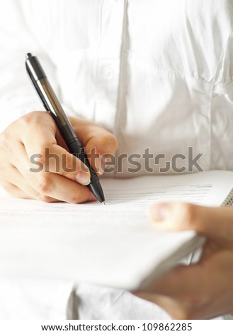 Woman write on document - stock photo