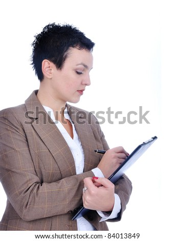 Woman writing on clipboard - stock photo