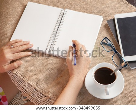 woman writing shot memories note on white paper with relaxing time and emotion - stock photo