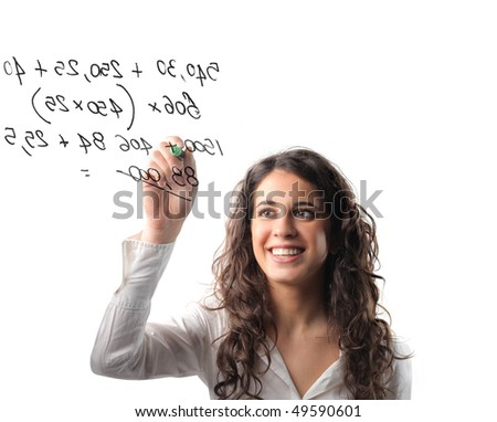 Woman writing some numbers with a marker - stock photo