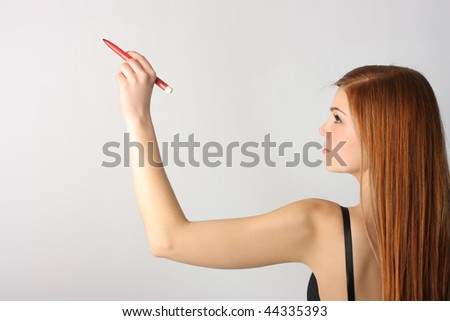 woman writing with red felt pen - stock photo