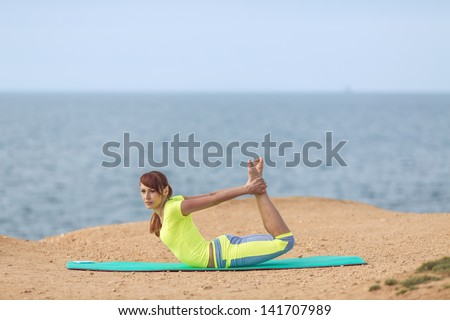 Woman yoga. Series. Outdoor. Seashore. Aerobics.