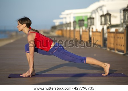 Woman Yoga. Sport. Yoga. Yoga seashore. Beach yoga. Sunrise yoga - stock photo