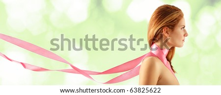 woman young beautiful with pink ribbon over light green background - stock photo