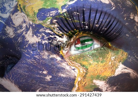 womans face with planet Earth texture and abkhazian flag inside the eye. Elements of this image furnished by NASA. - stock photo