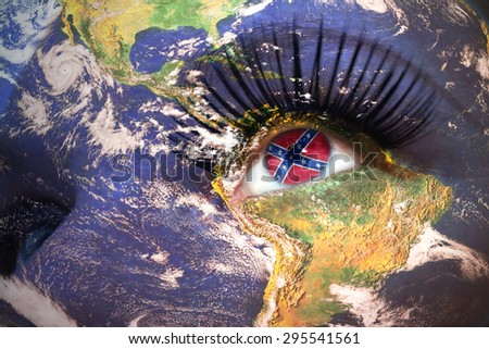 womans face with planet Earth texture and confederate navy  jack flag inside the eye. Elements of this image furnished by NASA.