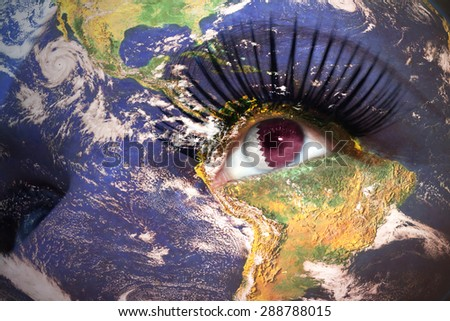 womans face with planet Earth texture and qatar flag inside the eye. Elements of this image furnished by NASA. - stock photo