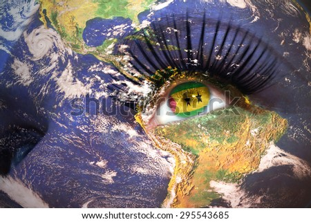 womans face with planet Earth texture and Sao Tome and Principe flag inside the eye. Elements of this image furnished by NASA. - stock photo