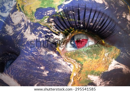 womans face with planet Earth texture and texas state flag inside the eye. Elements of this image furnished by NASA. - stock photo