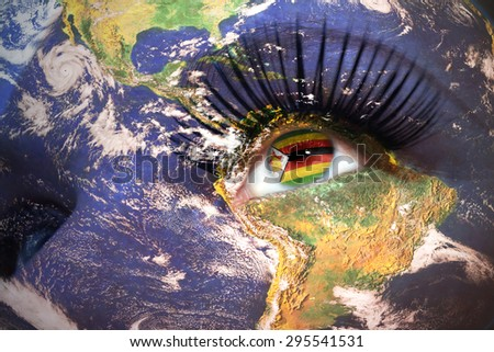 womans face with planet Earth texture and zimbabwean flag inside the eye. Elements of this image furnished by NASA. - stock photo