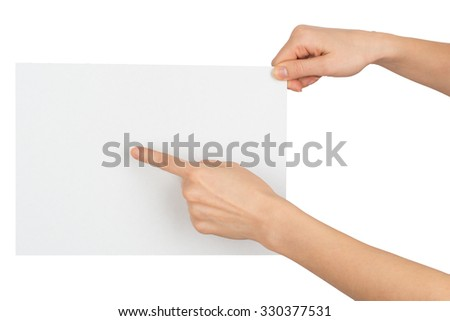 Womans hand pointing at blank paper on isolated white background - stock photo