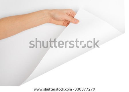 Womans hand turning empty page corner on isolated white background