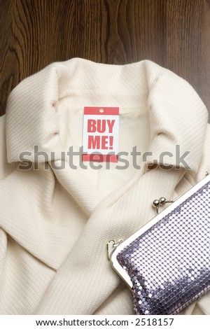 womans jacket with buy me tag - stock photo