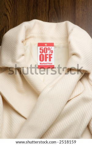 womans jacket with 50% off tag - stock photo