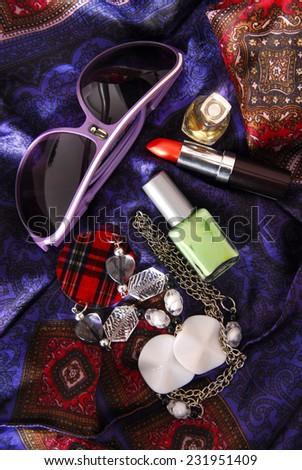 women accessories on silky scarf - stock photo