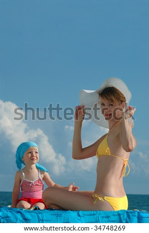 Women and child on the beach