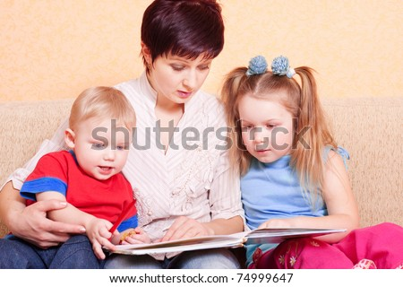 women and children with book - stock photo
