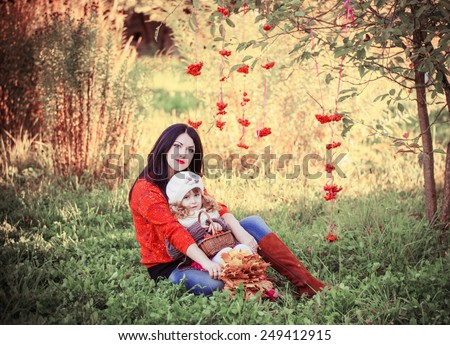 women and little girl n autumnal park