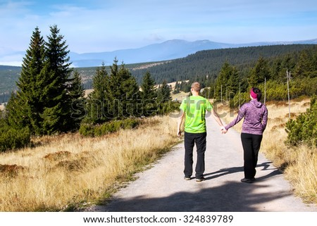 Women and man looks out over the mountains, Czech mountains Krkonose
