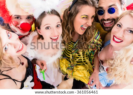 Women and men celebrating at party for new years eve or carnival - stock photo