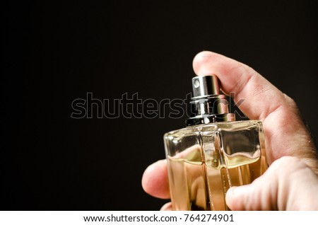women and men perfumes, on a dark background