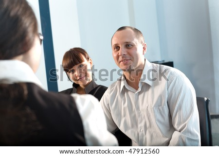 Women and men with girl in black jacket - stock photo