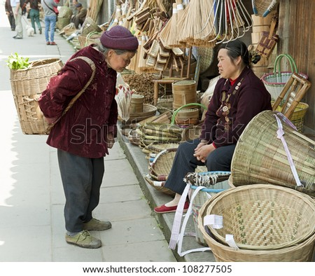 women and traditional hand tools in a little town - stock photo