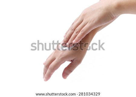Women applying hand cream to hands in isolated on white background