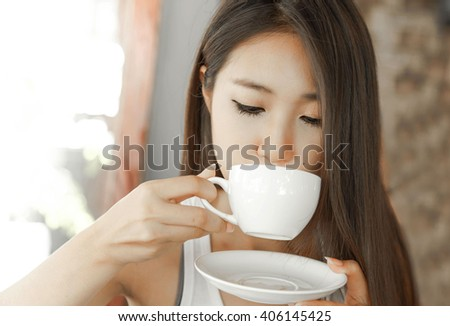 Women are drinking coffee cafe.relax woman in a cafe.Happy woman in a cafe. - stock photo
