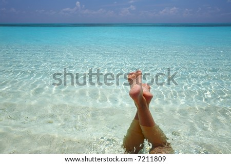 Women are relaxinhg in the  warm water of the Indian Ocean