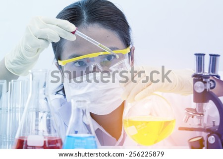 Women are working in research laboratories. - stock photo