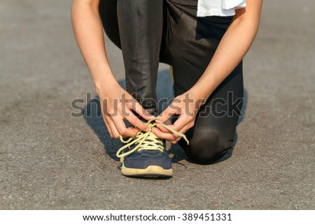 women asia sport, fitness, exercise and lifestyle concept - runner woman lacing trainers shoes - stock photo