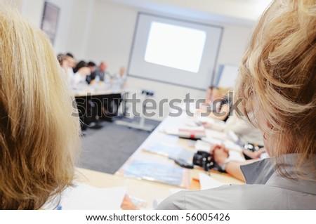 Women at business seminar. - stock photo