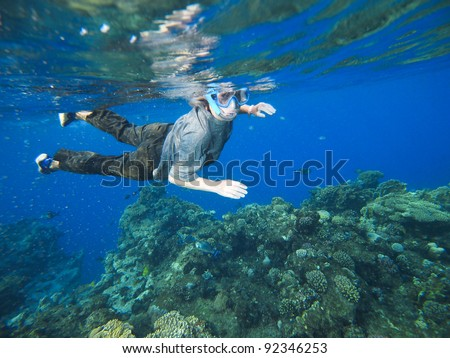 women at snorkeling in the Red Sea - stock photo