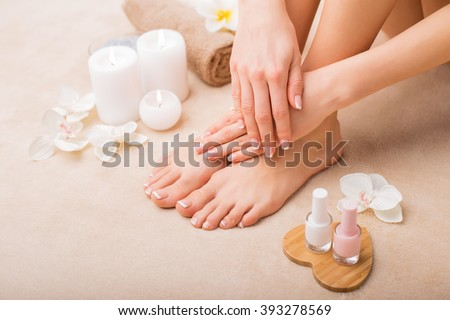 Women at spa salon after manicure and pedicure  - stock photo