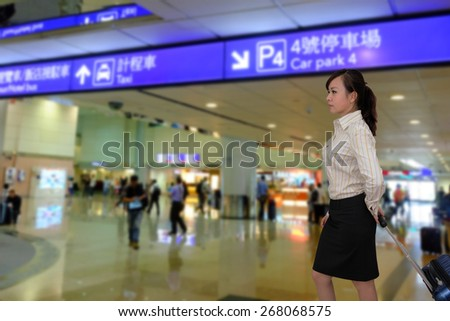women at the airport with luggage - stock photo