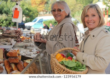 Women at the market together - stock photo