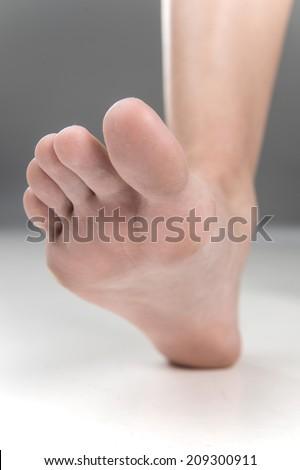 Women beautiful Foot stepping closeup. feet walking on floor with fingers closeup - stock photo