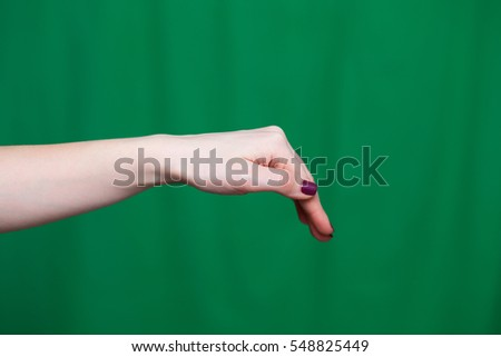 Women bent hand on a green background