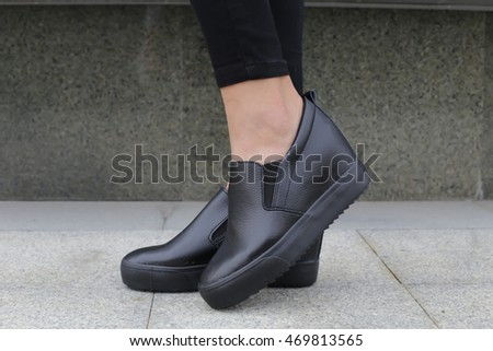 Women black sneakers