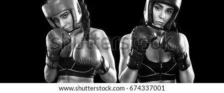 Women boxer fighting. Isolated on black background. Sport concept.