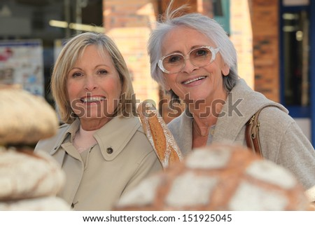 Women buying bread - stock photo
