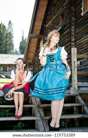 Women by a wooden Hut in Austria
