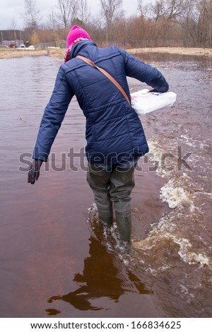 women carrying supply food  to rural house - stock photo