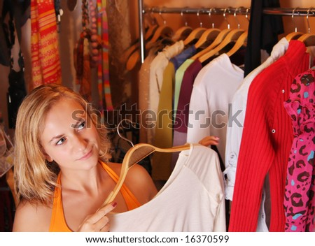 Women chooses clothes - stock photo