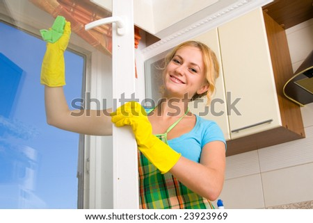 Women cleaning a window 3 - stock photo